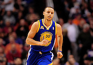 Feb. 22, 2012; Phoenix, AZ, USA;  Golden State Warriors guard Stephen Curry (30) reacts on the court against the Phoenix Suns at the US Airways Center.  The Warriors defeated the Suns 106 - 104. Mandatory Credit: Jennifer Stewart-US PRESSWIRE.