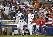 March 12, 2017 - Miami, FL, USA - United States third baseman Nolan Arenado is congratulated by third base coach Willie Randolph after hitting a three-run home run during the second inning of a World Baseball Classic first round Pool C game against Canada on Sunday, March 12, 2017 at Marlins Park in Miami, Fla. (Credit Image: © David Santiago/TNS via ZUMA Wire)