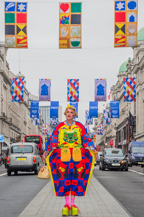 Royal Academician Grayson Perry, with Rose Wylie's street flags in Regents Street, London's West End.  It was part of the celebrations of the RA 250, their 250th Anniversary.