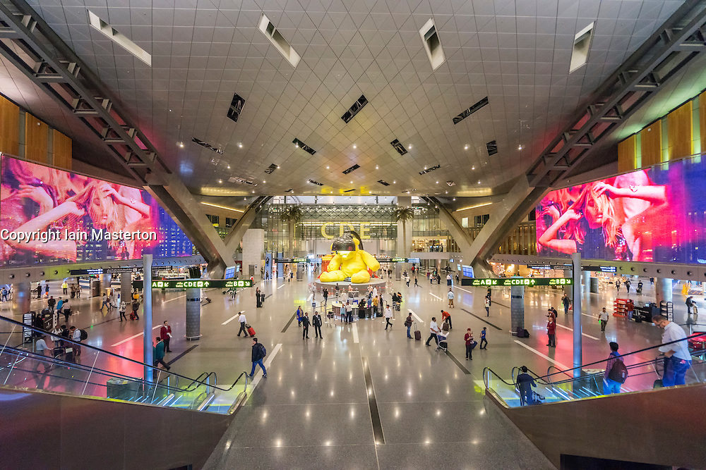 Interior of modern passenger terminal building at new Hamad International Airport in Doha Qatar