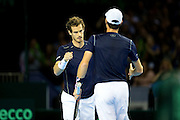 Andy Murray of Great Britain and Jamie Murray of Great Britain celebrate winning a point during the 2016 Davis Cup Semi Final between Great Britain and Argentina at the Emirates Arena, Glasgow, United Kingdom on 17 September 2016. Photo by Craig Doyle.