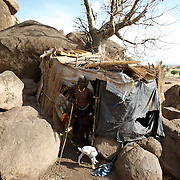 April 28, 2012 - Buram, Nuba Mountains, South Kordofan, Sudan: A Nuba elder at an improvised house in the caves outside Buram village in South Kordofan's Nuba Mountains...Since the 6th of June 2011, the Sudan's Army Forces (SAF) initiated, under direct orders from President Bashir, an attack campaign against civil areas throughout the South Kordofan's province. Hundreds have been killed and many more injured...Local residents, of Nuba origin, have since lived in fear and the majority moved from their homes to caves in the nearby mountains. Others chose to find refuge in South Sudan, driven by the lack of food cause by the agriculture production halt due to the constant bombardments of rural areas. (Paulo Nunes dos Santos/Polaris)