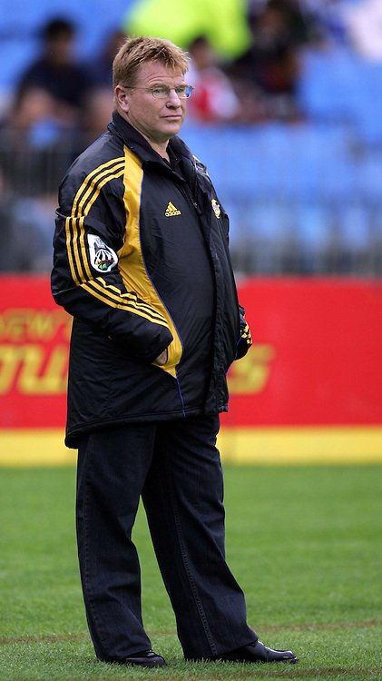 Hurricanes assistant coach Aussie McLean watches on before the Rebel Sport Super 14 game between the Blues and the Hurricanes at Eden Park, Auckland, New Zealand on Friday 10 February 2006. The Hurricanes won the match 37-19. Photo: Tim Hales/PHOTOSPORT<br />