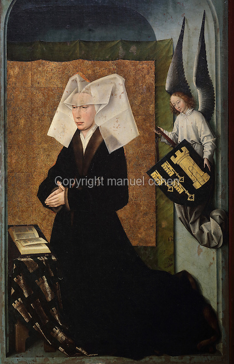 Guigone de Salins kneeling in prayer, from the closed panels of the polyptych altarpiece, 1446-52, by Rogier van der Weyden, 1399-1464, commissioned by Nicolas Rolin in 1443, in Les Hospices de Beaune, or Hotel-Dieu de Beaune, a charitable almshouse and hospital for the poor, built 1443-57 by Flemish architect Jacques Wiscrer, and founded by Nicolas Rolin, chancellor of Burgundy, and his wife Guigone de Salins, in Beaune, Cote d'Or, Burgundy, France. The altarpiece was originally in the Chapel, but is now in the museum. The panels were only opened to patients during holy days. The hospital was run by the nuns of the order of Les Soeurs Hospitalieres de Beaune, and remained a hospital until the 1970s. The building now houses the Musee de l'Histoire de la Medecine, or Museum of the History of Medicine, and is listed as a historic monument. Picture by Manuel Cohen