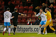 Crawley players protest as Referee Darren Drysdale awards a penalty to Crewe, during the EFL Sky Bet League 2 match between Crewe Alexandra and Crawley Town at Alexandra Stadium, Crewe, England on 11 February 2020.