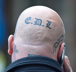 EDL leaders Tommy Robinson and Kevin Carrol appear in court,<br /> In the image - the back of the head of a EDL supporter. <br /> English Defence League, leaders Kevin Carroll and Tommy Robinson appear at the Westminster Magistrates' Court. Robinson, whose real name is Stephen Yaxley-Lennon, and Carroll are accused of obstructing police by trying to defy a ban on marching to the scene of Fusilier Lee Rigby's murder via the East London Mosque on June 29, 2013, London, United Kingdom. Wednesday, 11th September 2013. Picture by Piero Cruciatti / i-Images