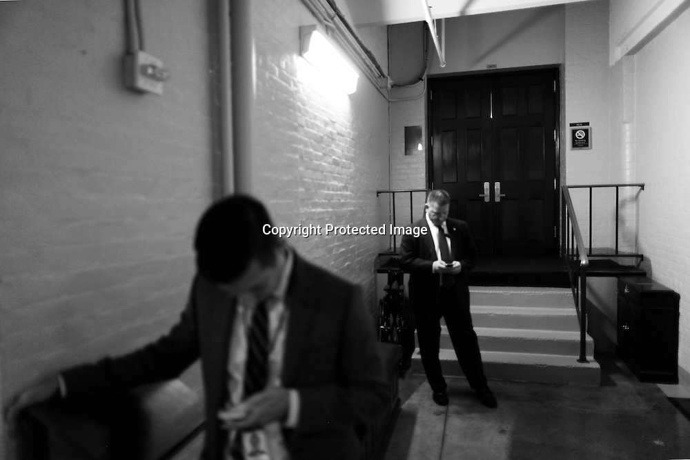 U.S. House of Representatives staff and security wait outside a closed-door Republican caucus meeting at the U.S. Capitol in Washington, October 15, 2013. A month of combat in the U.S. Congress over government spending showed signs on Monday of giving way to a Senate deal to reopen shuttered federal agencies and prevent an economically damaging default on federal debt.