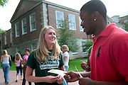 "Laura Ulmer and Jerome Williams chat during the activities fair held for the 2006 freshman class on the College Green...OPENING SCHOOL IN STYLE -- Members of the 2006 freshman class at Ohio University will get their college careers off on the right foot, both literally and figuratively, with the traditional march through the College Gate at approximately 3:15 p.m. Monday, Sept. 4. Following the President's Convocation at 2:30 p.m. in the Convocation Center, the new Bobcats will follow ""The Most Exciting Band in the Land,"" the Marching 110, from the Convo for the trek up Richland Avenue toward the College Green as they officially begin their college careers..Once on the College Green, representatives of more than 200 student organizations across campus will have displays set up to introduce the newest Ohio University students to the many ways to become actively involved in campus life..It is a colorful tradition that captures the spirit of college life. It also makes for tremendous photo and video opportunities for a unique twist on the conventional moving-in activities as the academic years of schools, colleges and universities across the state hit full stride over Labor Day Weekend."