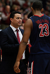 February 3, 2011; Stanford, CA, USA;  Arizona Wildcats head coach Sean Miller (left) talks to forward Derrick Williams (23) during a time out against the Stanford Cardinal during the second half at Maples Pavilion.  Arizona defeated Stanford 78-69.