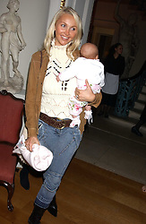 HEATHER TCHENGUIZ and her baby at the Bruce Oldfield Crimestoppers Party held at Spencer House, 27 St.James's Place, London SW1 on 22nd September 2005.<br /><br />NON EXCLUSIVE - WORLD RIGHTS