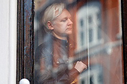 © Licensed to London News Pictures. 19/05/2017. London, UK. Wikileaks founder JULIAN ASSANGE gets on the balcony of Ecuadorian embassy in London before speaking on Friday 19 May 2017. Today the Swedish authorities have announced that they are dropping their investigation into rape allegations against him. Photo credit: Tolga Akmen/LNP