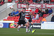Colchester United midfielder Sammie Szmodics (10)  takes on Doncaster Rovers defender Joe Wright (15)  during the EFL Sky Bet League 2 match between Doncaster Rovers and Colchester United at the Keepmoat Stadium, Doncaster, England on 15 October 2016. Photo by Simon Davies.