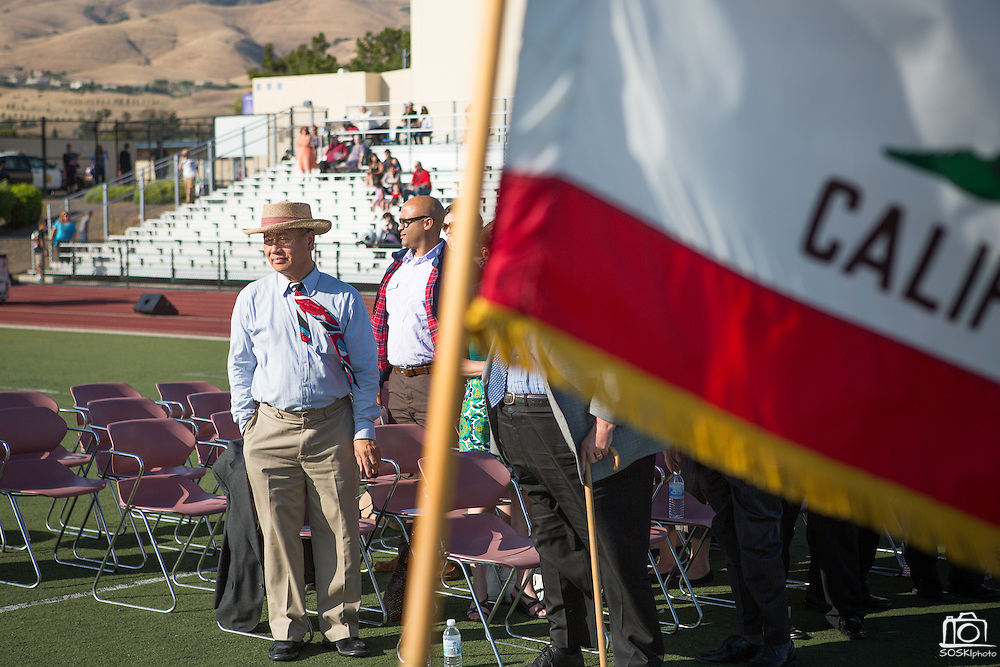 Milpitas Mayor Jose Esteves watches the Cal Hills Class of 2012 graduation processional enter the Milpitas High School football field on June 15, 2012.  Photo by Stan Olszewski/SOSKIphoto.