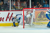REGINA, SK - MAY 19: Artyom Minulin #5 of Swift Current Broncos falls over Jeffrey Truchon-Viel #25 of Acadie-Bathurst Titan behind the net during first period at the Brandt Centre on May 19, 2018 in Regina, Canada. (Photo by Marissa Baecker/CHL Images)