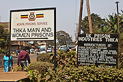 The signs outside Thika's main and women's prison. One shows the different industries that happen inside the prison. Action for children in conflict (AFCIC) work closely with the prison helping to provide day care, clothes and resources for the children that live inside.