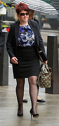 © Licensed to London News Pictures. 08/05/2013 London, UK. Tracey Bell, 34 arrives at Westminster Magistrates Court. The Sandhurst pharmacy assistant is charged with misconduct in a public office allegedly receiving £1250.00 in 2006 relating to 5 articles printed in The Sun..Photo credit : Simon Jacobs/LNP