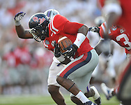 Ole Miss defensive back Chief Brown (8) recovers a fumble by Central Arkansas' Jackie Hinton (5) at Vaught-Hemingway Stadium in Oxford, Miss. on Saturday, September 1, 2012.