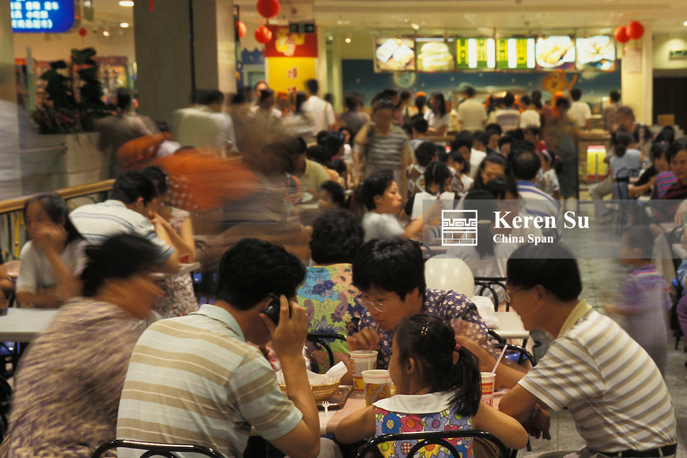 People dining at local restaurant, Shanghai, China