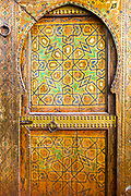 FEZ, MOROCCO - 31st OCTOBER 2013 - Old Moroccan doorway with intricately painted geometric patterns and designs, Old Fez Medina, Middle Atlas Mountains, Morocco.