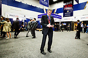 Former US Senator and early Trump endorser Scott Brown (R-Ma) checks his phone in the spin room. The Democrate and Republican nominees for US President, Hillary Rodham Clinton and Donald John Trump, met on Sep. 26th for the first head to head Presidential Debate at the Hofstra University in Long Island.