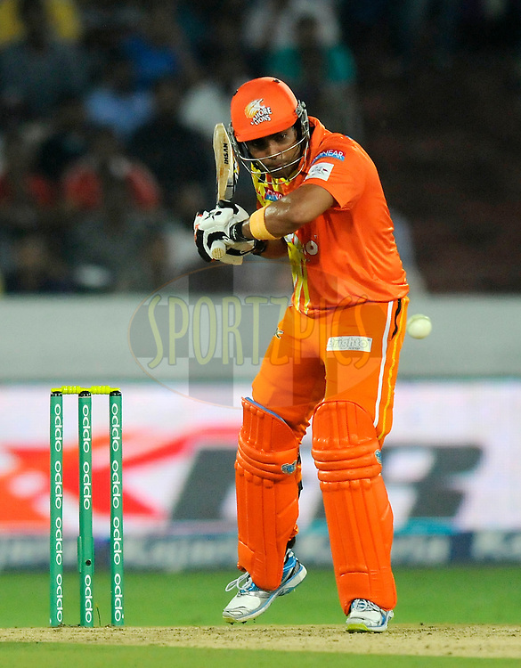 Umar Akmal of Lahore Lions bats during match 7 of the Oppo Champions League Twenty20 between the Kolkata Knight Riders and the Lahore Lions held at the Rajiv Gandhi Cricket Stadium, Hyderabad, India on the 21st September 2014<br /> <br /> Photo by:  Pal Pillai / Sportzpics/ CLT20<br /> <br /> <br /> Image use is subject to the terms and conditions as laid out by the BCCI/ CLT20.  The terms and conditions can be downloaded here:<br /> <br /> http://sportzpics.photoshelter.com/gallery/CLT20-Image-Terms-and-Conditions-2014/G0000IfNJn535VPU/C0000QhhKadWcjYs
