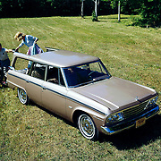 A 1964 Studebaker Daytona Wagonaire is shown in this publicity image. The Wagonaire featured Studebaker's exclusive sliding roof.