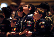 5 FEB. 2012 -- ST. LOUIS  -- Cub Scouts pause during the presentation of awards during a Scout Sunday prayer service led by the Most Rev. Edward F. Rice, Auxiliary Bishop of the Archdiocese of St. Louis, Sunday, Feb. 5, 2012.  Photo © copyright 2012 Sid Hastings.