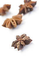 Close-up of anise on white background