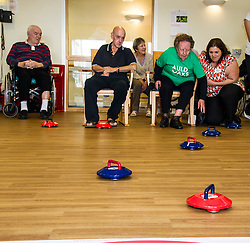 Pictured: John Cormack (Inchview Care Home) and Ellen Linton (96) (Oakland Care Home) went head to head in the Curling <br /> <br /> First-ever care home games tournament took place over two days at Edinburgh's Inchview Care home. More than 90 athletes from other care homes gathered to  compete in events including javelin, curling and dancing. <br /> <br /> <br /> <br /> Ger Harley | EEm 27 July 2016