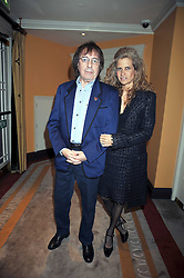 BILL WYMAN and his wife SUZANNE at the 3rd Fortune Forum Summit held at The Dorchester Hotel, Park Lane, London on 3rd March 2009.
