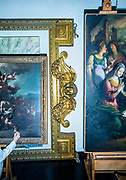 Rome, the coservative studio Merlini Storti, two paintings and a majestic frame that are under restoration inside the studio