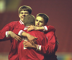 LIVERPOOL, ENGLAND - Tuesday, January 7, 1997: Liverpool's Michael Owen celebrates scoring from the penalty spot Manchester United with team-mate Steven Gerrard during the FA Youth Cup match at Anfield. United won 2-1. (Pic by David Rawcliffe/Propaganda)