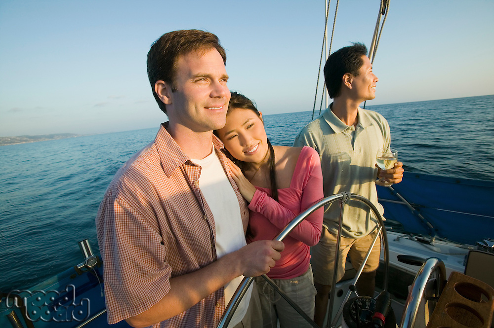 Couple with Friend on Boat