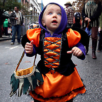 13-month old Mateya Foster, of Santa Cruz, is wide-eyed with amazement as she trick-or-treats dressed as a monarch butterfly along Pacific Avenue in downtown Santa Cruz, California on Friday October 31, 2014. (Shmuel Thaler -- Santa Cruz Sentinel)