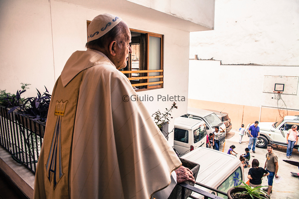 Padre Ugo subito dopo la messa domenicale con i volontari dell'OMG a Lima Chacas, Ancash, Peru. A group of brave Italian volunteers of the no-profit Italian movement OMG, Operazione Mato Grosso, together with their spiritual leader Father Ugo De Censi, fight against poverty and misery in the villages of the Peruvian Andes since 1967, helping these poor people with their hard work. They gave everything for them, they dedicated their life to them, without never asking anything in return. A great life adventure, based on compassion and love.