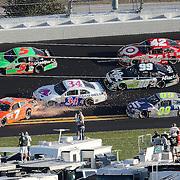 Sprint Cup Series driver Robby Gordon (7) loses control in turn 2  during the Daytona 500 at Daytona International Speedway on February 20, 2011 in Daytona Beach, Florida. (AP Photo/Alex Menendez)