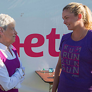 August 19, 2014, New Haven, CT:<br /> Connecticut Lieutenant Governor Nancy Wyman talks with Coco Vandeweghe during a Girl Scout Night clinic on day five of the 2014 Connecticut Open at the Yale University Tennis Center in New Haven, Connecticut Tuesday, August 19, 2014.<br /> (Photo by Billie Weiss/Connecticut Open)