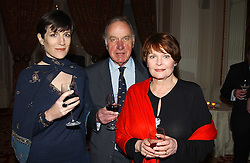Left to right, actor GEOFFREY PARKER, actress HARRIET WALTER and actress ISLA BLAIR at a reception following a charity carol service in aid of the Mental Health Foundation attended by HRH Princess Michael of Kent and held at the Hype Park Mandarin Oriental Hotel, Knightsbridge, London on 30th November 2004.<br />
