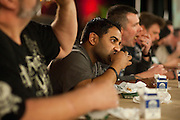 Palu Patel competes in the wing eating contest during ZestFest at the Irving Convention Center on Saturday, January 26, 2013 in Irving, Texas. (Cooper Neill/The Dallas Morning News)