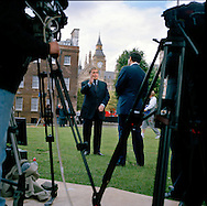 UK. London. From a story on Abingdon Street Gardens, a small patch of land, often referred to as College Green, that lies next to The Houses of Parliament in Westminster. It is a place where the media and the politicians come face to face. Interviews are held, photo shoots are set up and bewildered tourists stroll by..Photo shows Former Deputy Prime Minister John Prescott talking to the BBC on the day Gordon Brown took over as British Prime Minister..Photo©Steve Forrest/Workers Photos