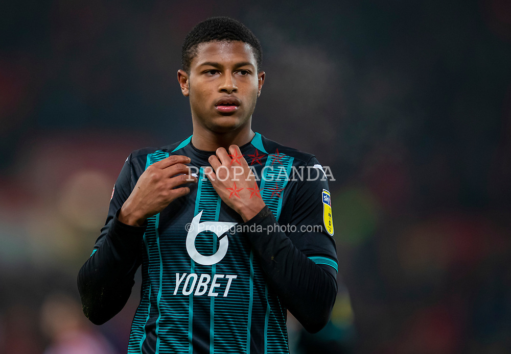 STOKE-ON-TRENT, ENGLAND - Saturday, January 25, 2020: Swansea City's Rhian Brewster takes off his shirt for supporters after the Football League Championship match between Stoke City FC and Swansea City FC at the Britannia Stadium. Swansea City lost 2-0. (Pic by David Rawcliffe/Propaganda)