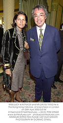 MISS LUCY WASTNAGE and MR DAVID TANG he is the Hong Kong millionire, at a luncheon in London on 24th April 2002.	OZI 54