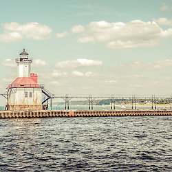 Saint Joseph Michigan Lighthouse retro panorama photo. The St. Joseph Lighhouse and pier catwalk are a popular local attraction. The panoramic photo ratio is 1:3.