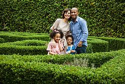 Portrait of Family in Garden Smiling