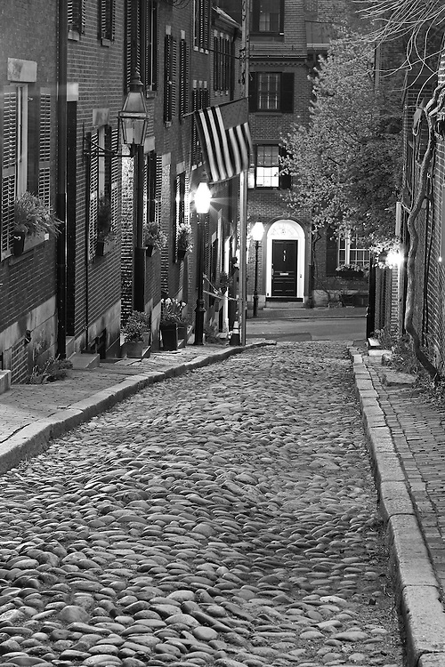 Black and White New England photography of the most photographed cobble stone street in Boston, Acorn Street. Acorn Street, often mentioned as the most frequently photographed street in the United States of America. It is a narrow lane paved with cobblestones that was home to coachmen employed by families in Mt. Vernon and Chestnut Street mansions.<br /> <br /> B&amp;W Boston Beacon Hill Acorn Street photos are available as museum quality photography prints, canvas prints, acrylic prints or metal prints. Fine art prints may be framed and matted to the individual liking and decorating needs:<br /> <br /> http://juergen-roth.pixels.com/featured/boston-acorn-street-juergen-roth.html<br /> <br /> All Boston Black and White photos are available for digital and print image licensing at www.RothGalleries.com. Please contact me direct with any questions or request.<br /> <br /> Good light and happy photo making!<br /> <br /> My best,<br /> <br /> Juergen<br /> Prints: http://www.rothgalleries.com<br /> Photo Blog: http://whereintheworldisjuergen.blogspot.com<br /> Instagram: https://www.instagram.com/rothgalleries<br /> Twitter: https://twitter.com/naturefineart<br /> Facebook: https://www.facebook.com/naturefineart