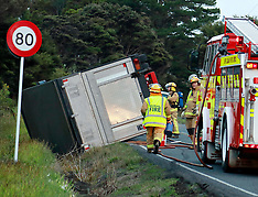 Auckland-Driver escapes injury after truck rolled, Waitakere Road