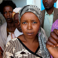 A woman waits for her chance to see a visiting doctor at a hospital in Gimbie, Ethiopia