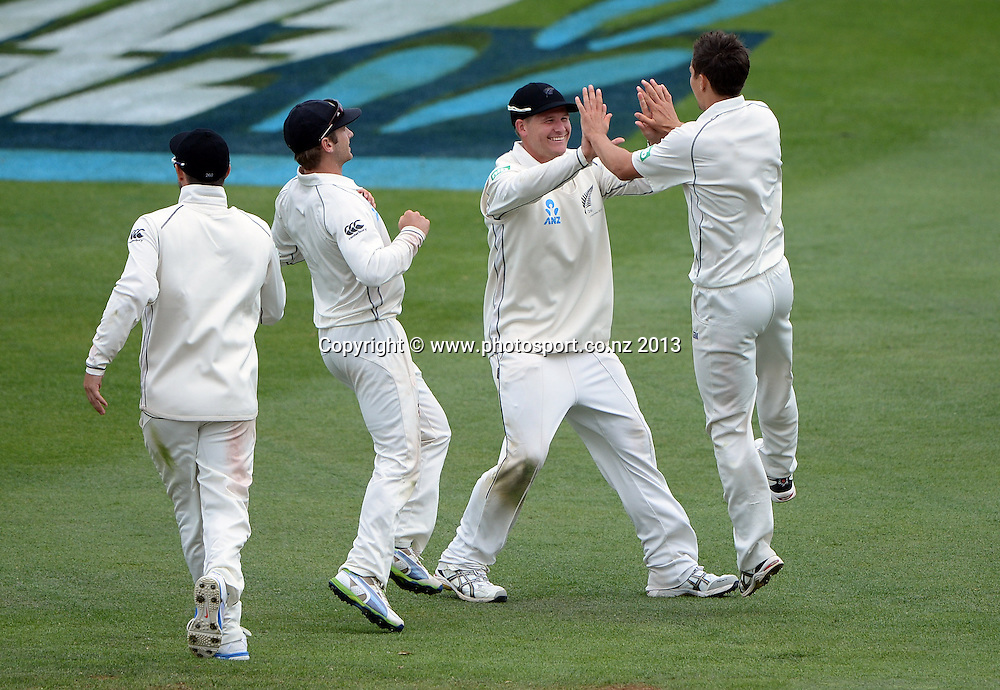 Trent Boult celebrates with team mates after taking 10 wickets to lead New Zealand to a win over the West Indies on Day 3 of the 2nd cricket test match of the ANZ Test Series. New Zealand Black Caps v West Indies at The Basin Reserve in Wellington. Friday 13 December 2013. Mandatory Photo Credit: Andrew Cornaga www.Photosport.co.nz