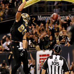 November 28, 2011; New Orleans, LA, USA; New Orleans Saints tight end Jimmy Graham (80) celebrates following a touchdown against the New York Giants during the second quarter of a game at the Mercedes-Benz Superdome. Mandatory Credit: Derick E. Hingle-US PRESSWIRE
