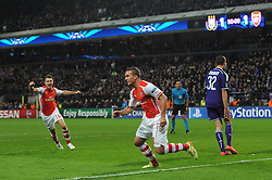 Arsenal's Lukas Podolski celebrates his winning goal in the last minute of the game - Photo mandatory by-line: Dougie Allward/JMP - Mobile: 07966 386802 - 22/10/2014 - SPORT - Football - Anderlecht - Constant Vanden Stockstadion - R.S.C. Anderlecht v Arsenal - UEFA Champions League - Group D